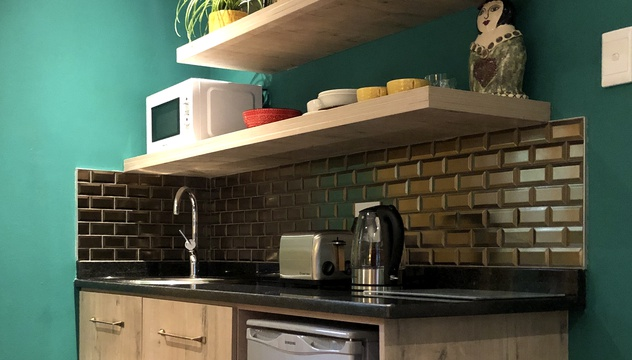 Kitchenette with microwave, toaster, kettle, cutlery etc